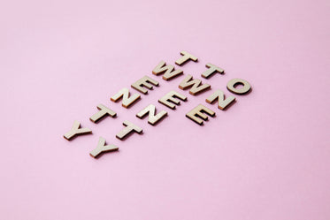 2021 words in wooden tiles on pink