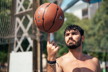 man spinning basketball on finger