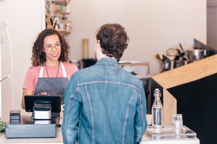 a-barista-chats-to-a-customer-at-the-cas