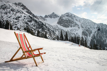 a beach chair on snow covered mountain