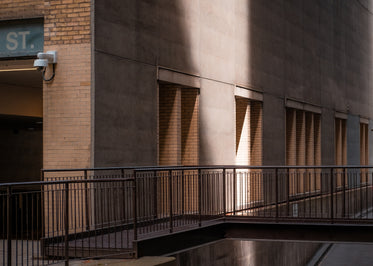 a beam of light strikes the side of a city building