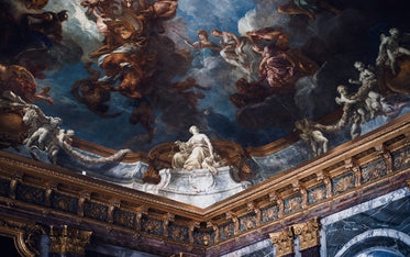 a beautiful ceiling mural from the palace of versailles