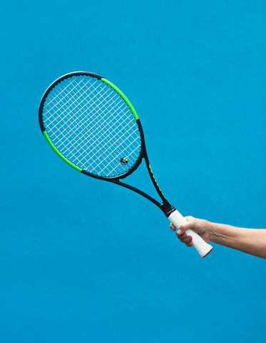 a black and green tennis racket