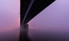 a bridge sitting in thick pink and purple fog