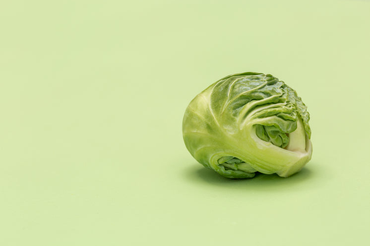 a-brussel-sprout-on-green-surface.jpg?wi