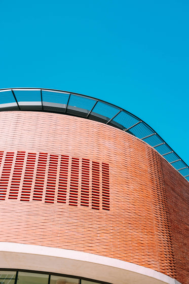 a building sheathed in weave pattern