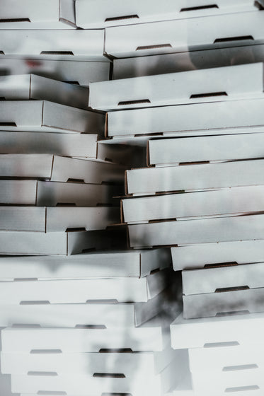 a bunch of cardboard pizza boxes
