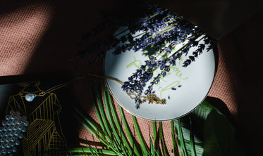 a busy flatlay with lavender and other home items