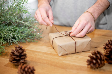 a christmas package being wrapped