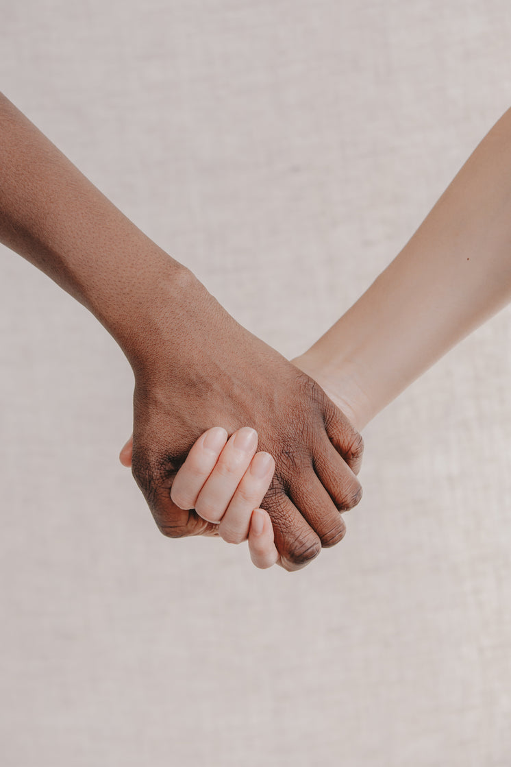 a-close-up-two-people-holding-hands-toge