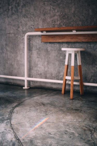 a counter and accompanying stool