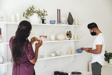 a couple looks at home goods