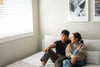 a couple relax on a white couch in their living room