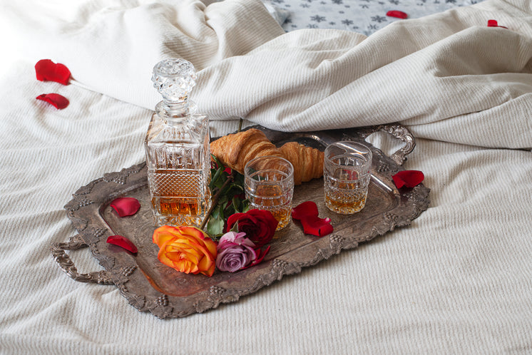 A Decanter And Croissants On A Silver Tray