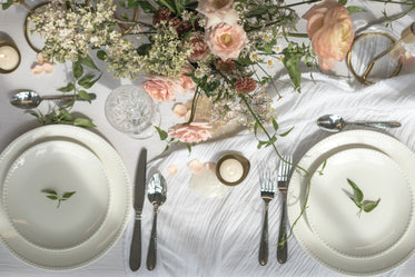 a dining table filled with floral decoration