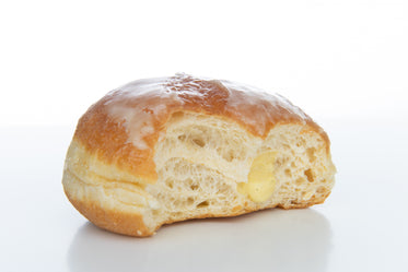 a doughnut with a few bites takes out of it