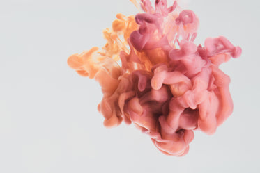 a drop of pink and yellow paint in water