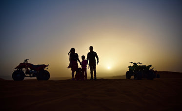 a family on a sunset quad-bike adventure
