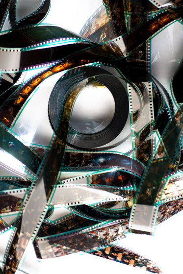 a film reel lays flat catching the sunlight
