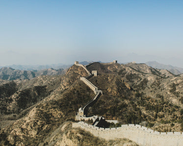 a great wall moves across the mountains