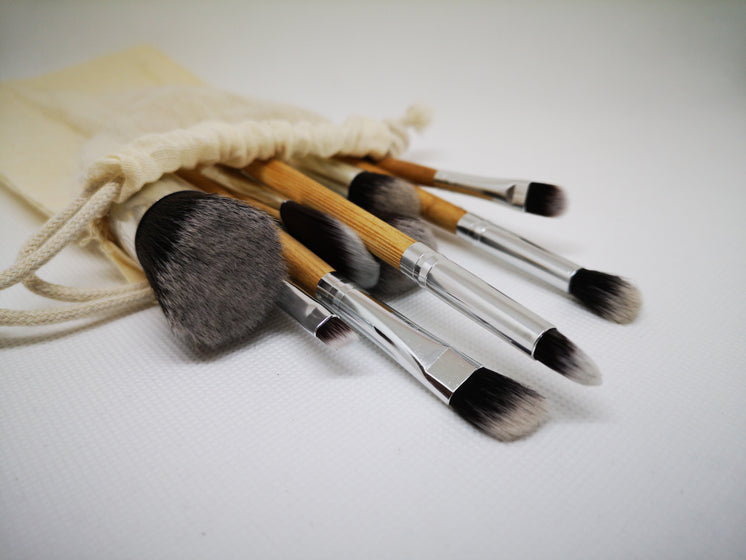 A Group Of Paint Brushes Spill Out Of A Cream Linen Bag