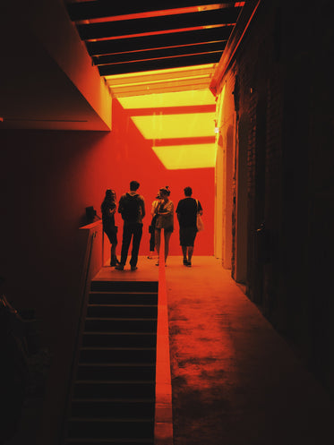 a group of people stand surrounded by a red glow