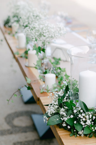 a line of white candle table centerpieces