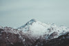 a lonely mountain covered in snow