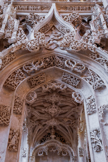 a marble archway with figures hewn into it