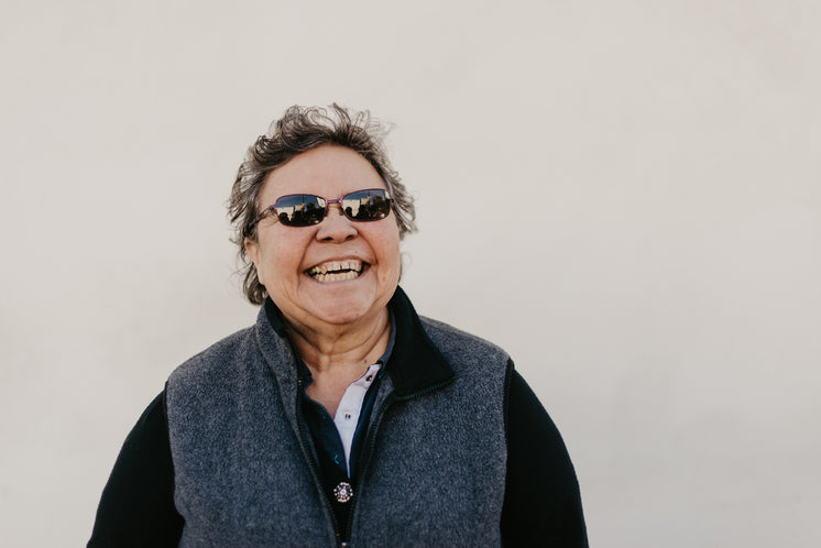 A Mature Woman With Sunglasses Laughing