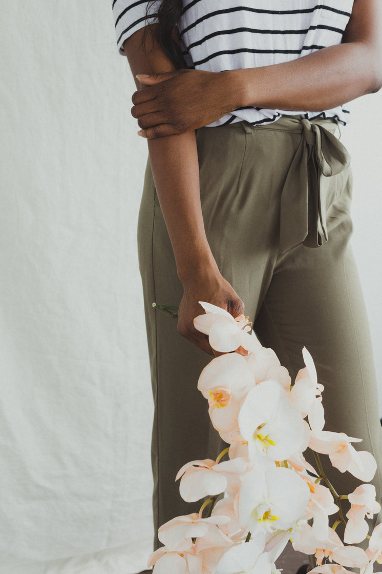 A Model In Khakis Holding Orchids