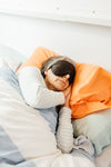 a person sleeps with a black eye mask on