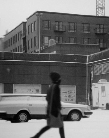 a person walking in a city in monochrome