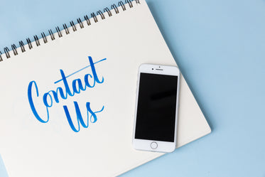 a phone on a blue background with 'contact us'