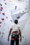 a rock climber takes in the sight of his next climb