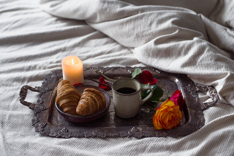 A Romantic Candle Lit Breakfast On A Silver Tray