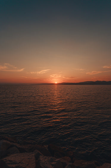 a setting sun dances on the water