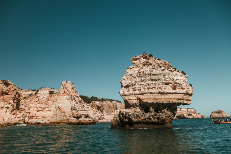 A Single Rocky Stack Emerges From Blue Waters