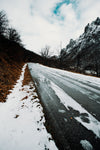 a slush covered lonely winter road