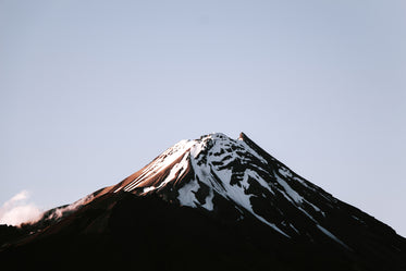 a snow capped mountain summit