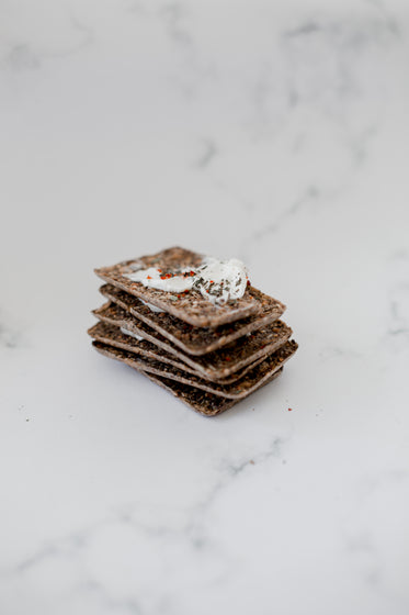 a stack of crackers on a marble counter top