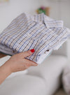 a stack of perfectly folded shirts