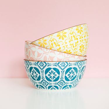 a stack of three patterned bowls of differing colors