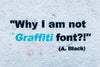 a statement in graffiti on white wall