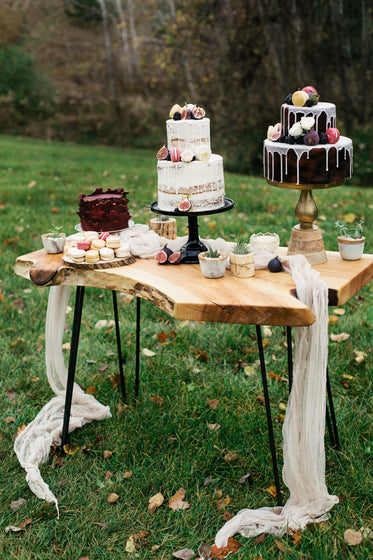 a stunning display of cakes and desserts on table