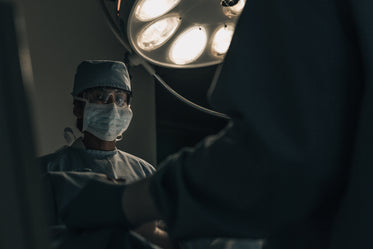 a surgeon in scrubs mid-operation