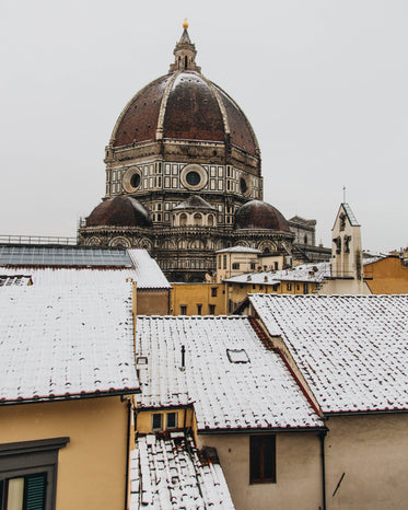 a tall cathedral in the snowy town