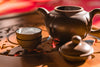 a tea set sitting on wooden table
