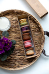 a tray with macarons and flowers