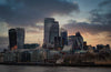 a view of the london cityscape at a cloudy sunset